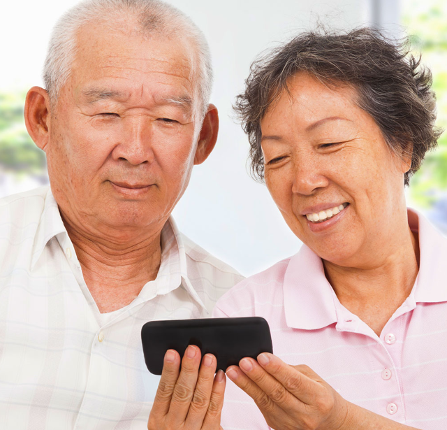 Contact Silverline happy elderly couple using smartphone